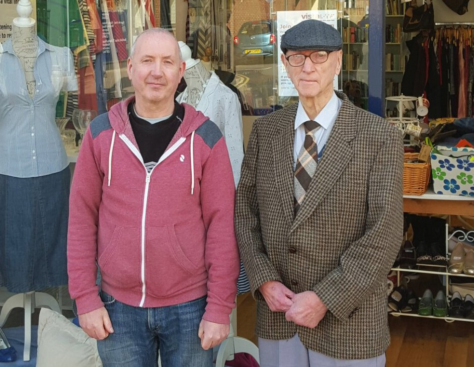 A picture of Robinett and his son, stood in front of Vista's charity shop in Loughborough.