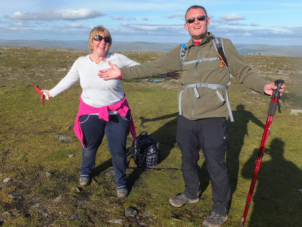 A picture of a man and woman hiking in the Three Peaks Challenge.