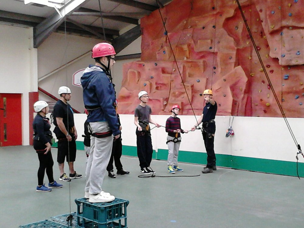 A picture of children and young people taking part in a crate stacking activity.