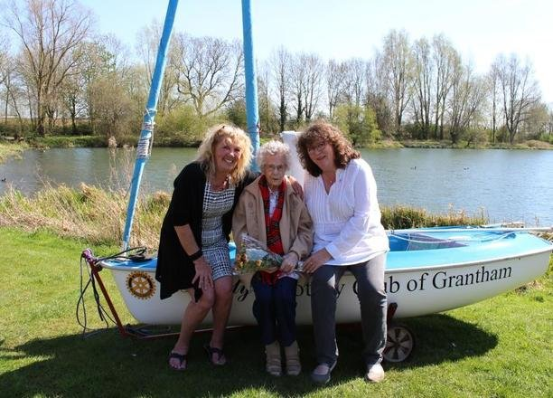 A picture of Residential Manager Julie Rudd and Margaret in front of the new dinghy.