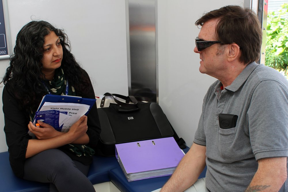 A picture of a staff member consulting a service user.