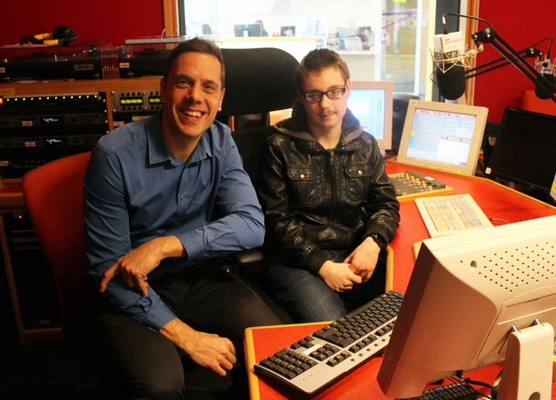 A picture of a radio presenter with Adam in the BBC Radio Leicester studio.