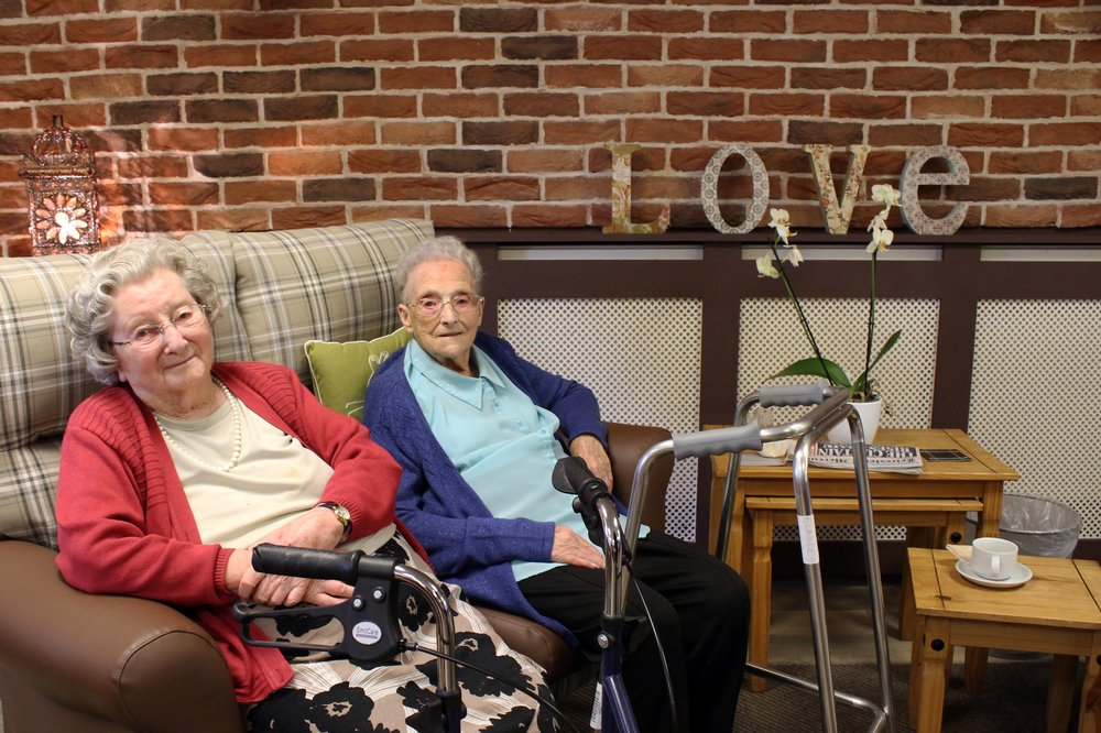 A picture of two residents sitting in the new lounge area at New Wycliffe Home.