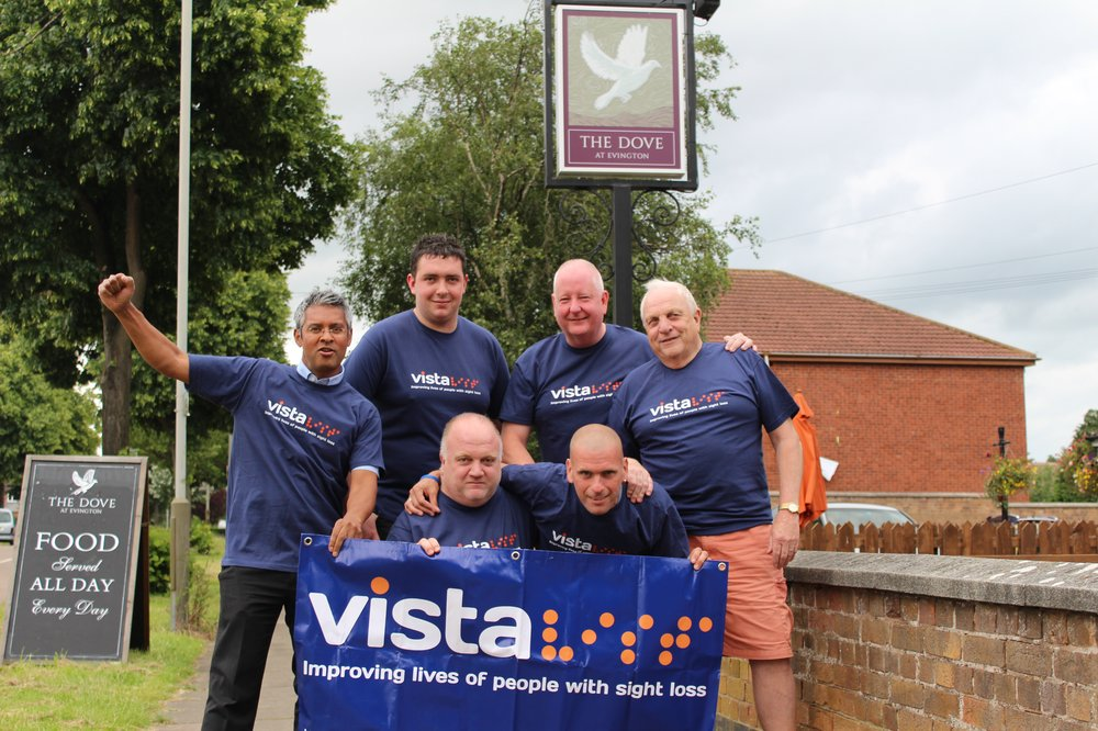Martyn with friends and family in Vista t-shirts and banners ahead of his fundraising walk