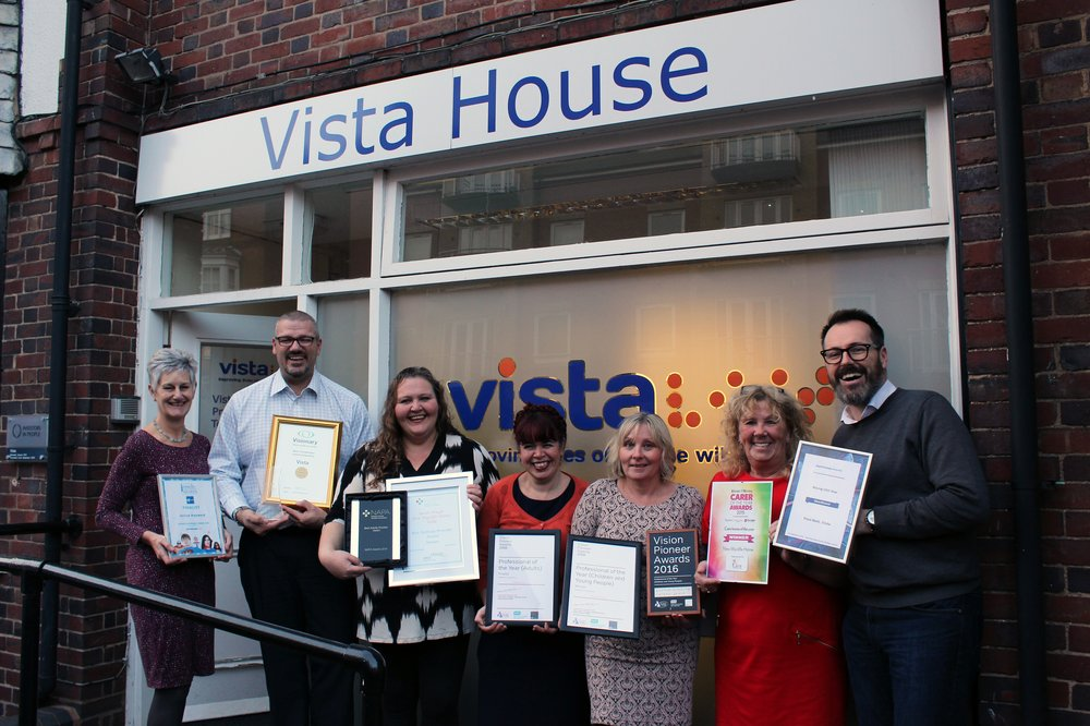 A picture of a group of Vista staff holding their award certificates outside Vista House.