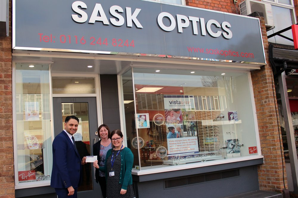 A picture of the team outside Sask Optics.