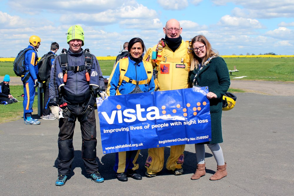 A picture of Indira, the skydive coach, and Vista's Fundraiser after Indira's skydive.