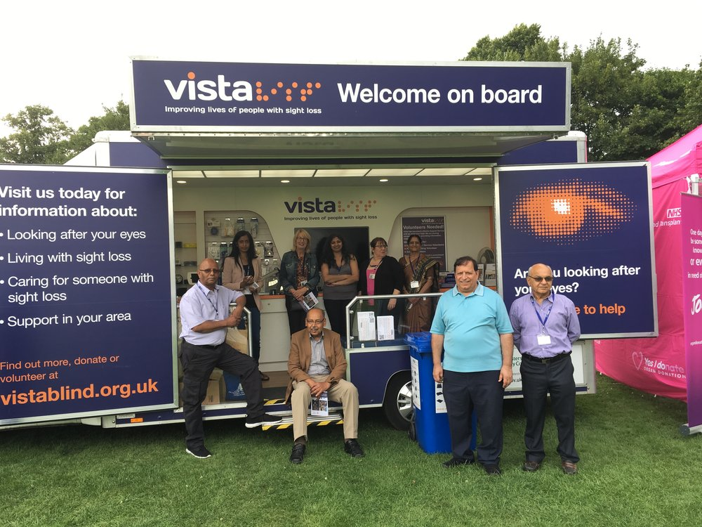 A picture of Vista staff and volunteers on the Mobile Support Service vehicle.
