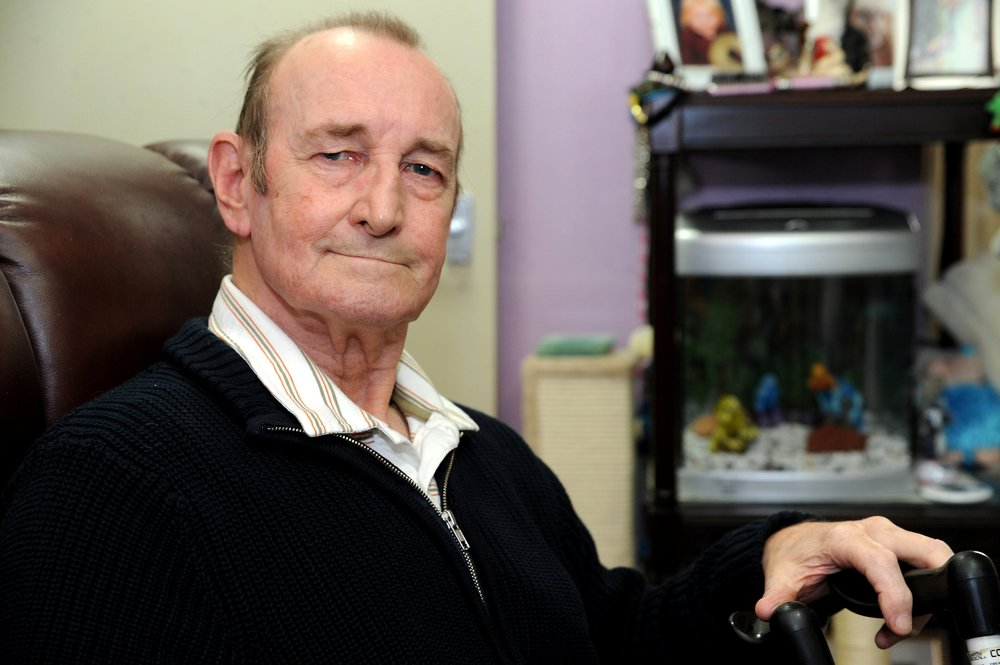 A picture of John Thorpe, a Vista service user, sat in an armchair.