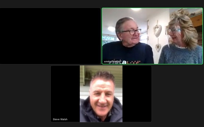 A screenshot of Leicester City Football Club legend Steve Walsh on Zoom talking to Tony and Teresa at Vista's Kathleen Rutland home wearing Vista t-shirts.