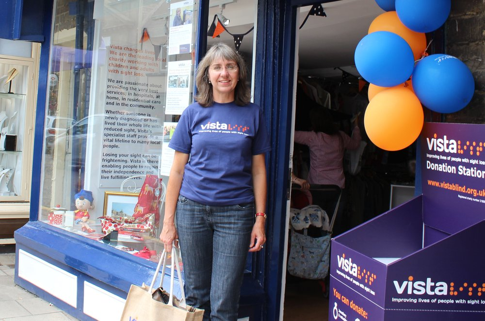 A picture of Louise, Volunteer Coordinator, in a Vista t-shirt with Vista balloons.