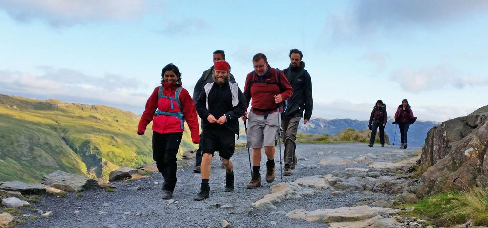 A picture of people trekking on the Three Peaks Challenge.