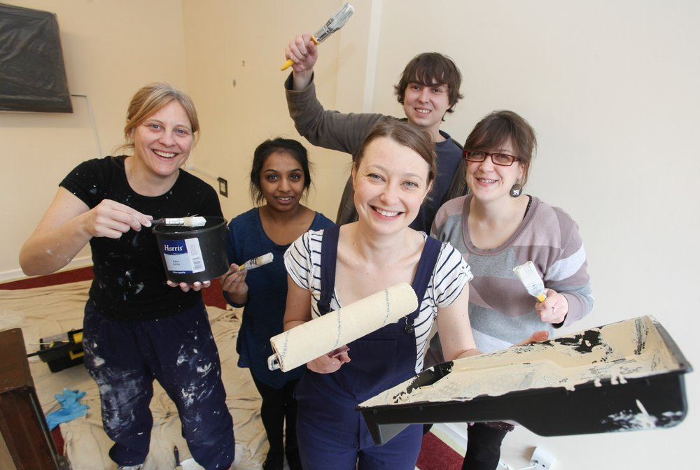 A picture of Nelsons staff members with decorating tools.