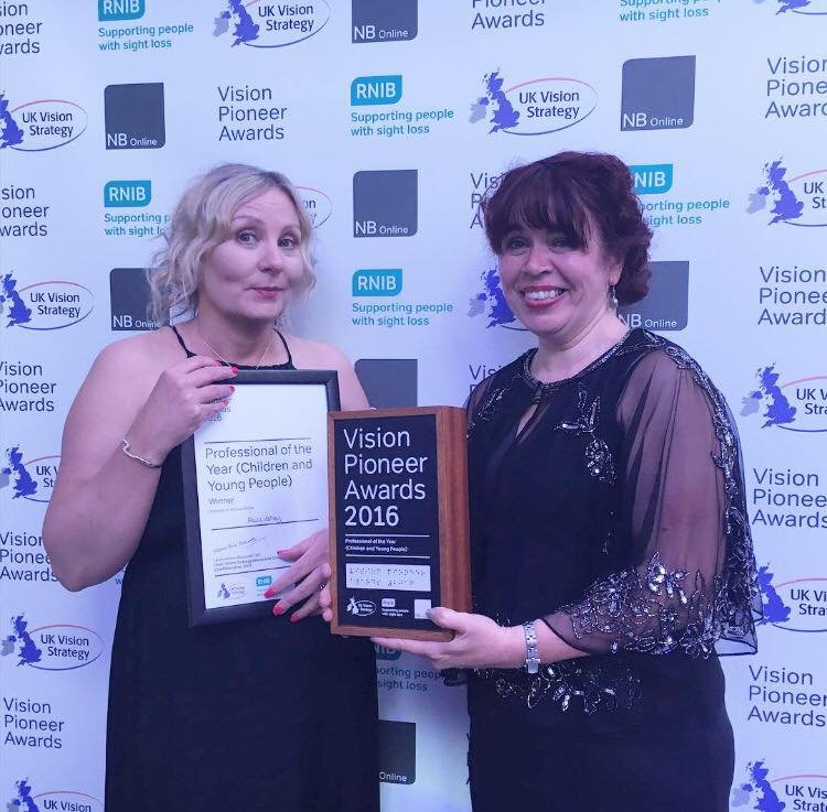 A picture of Paula Varney and Naomi Bell holding their award and certificate