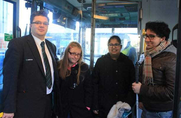 A picture of Arriva Midlands driver Darren Sewell with young people on the bus.