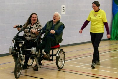 Vista member and her daughter cycle together in a tandem trike