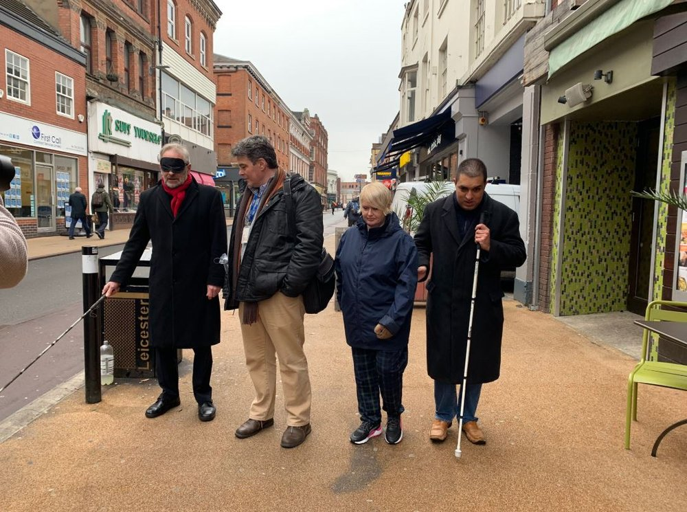 The Mayor with 3 vista representatives walking blindfolded with cane down Belvoir street