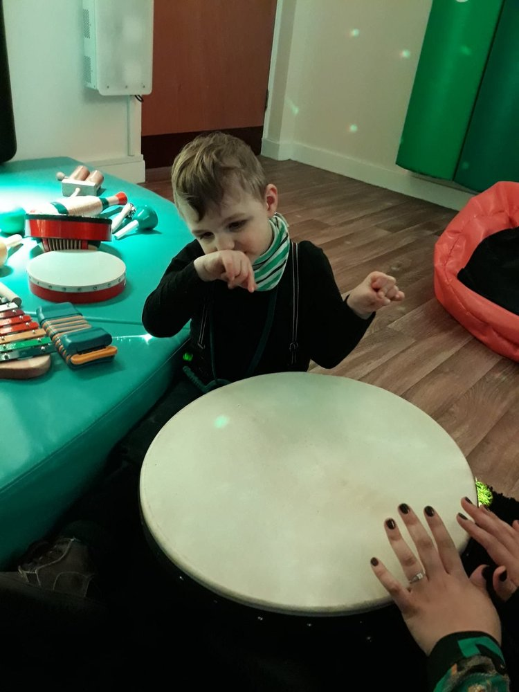 Image of little boy playing the the sensory room